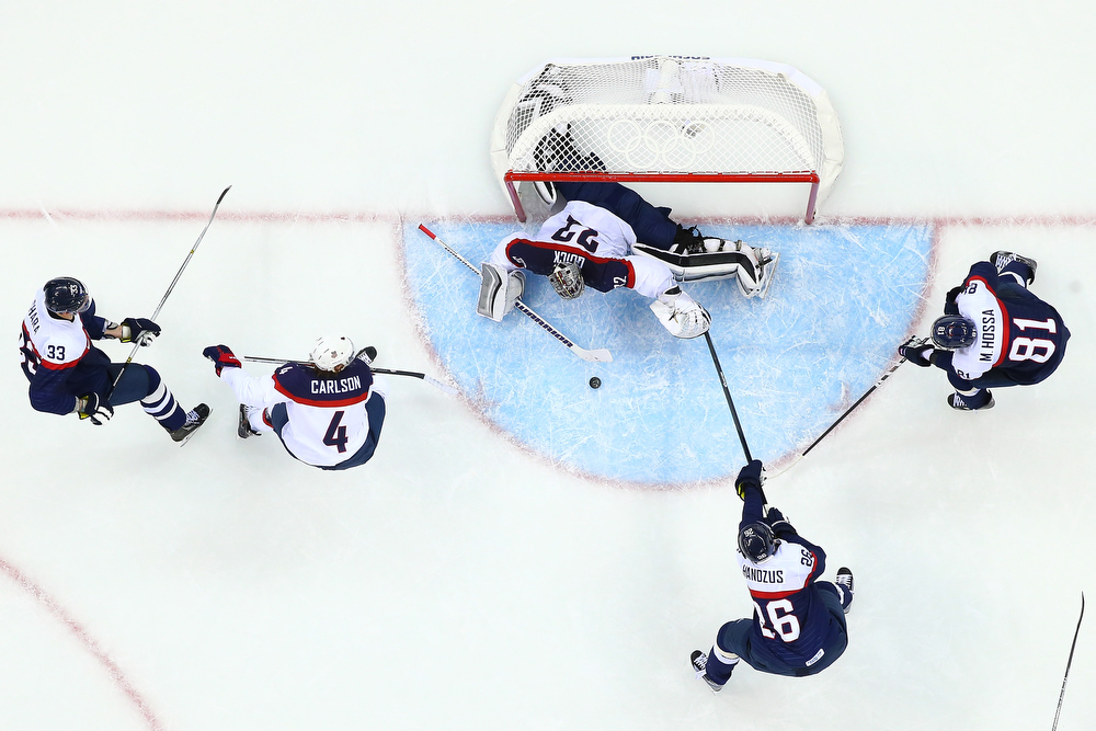 . Jonathan Quick #32 of United States attempts to save a goal against Slovakia during the Men\'s Ice Hockey Preliminary Round Group A game on day six of the Sochi 2014 Winter Olympics at Shayba Arena on February 13, 2014 in Sochi, Russia.  (Photo by Streeter Lecka/Getty Images)