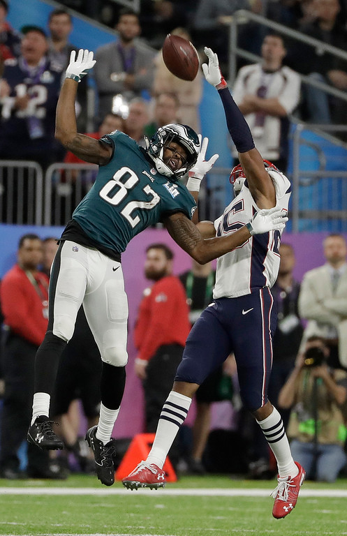 . New England Patriots\' Eric Rowe, right, breaks up a pass intended for Philadelphia Eagles\' Torrey Smith during the second half of the NFL Super Bowl 52 football game Sunday, Feb. 4, 2018, in Minneapolis. (AP Photo/Matt Slocum)
