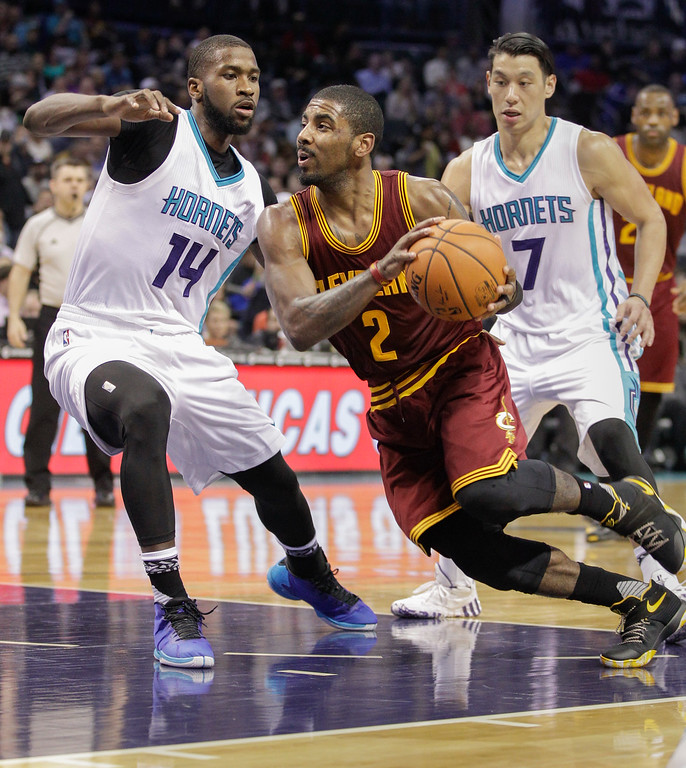 . Cleveland Cavaliers guard Kyrie Irving drives against Charlotte Hornets forward Michael Kidd-Gilchrist,  left, and guard Jeremy Lin during the second half of an NBA basketball game Wednesday, Feb. 3, 2016 in Charlotte, N.C. Charlotte won 106-97. (AP Photo/Nell Redmond)