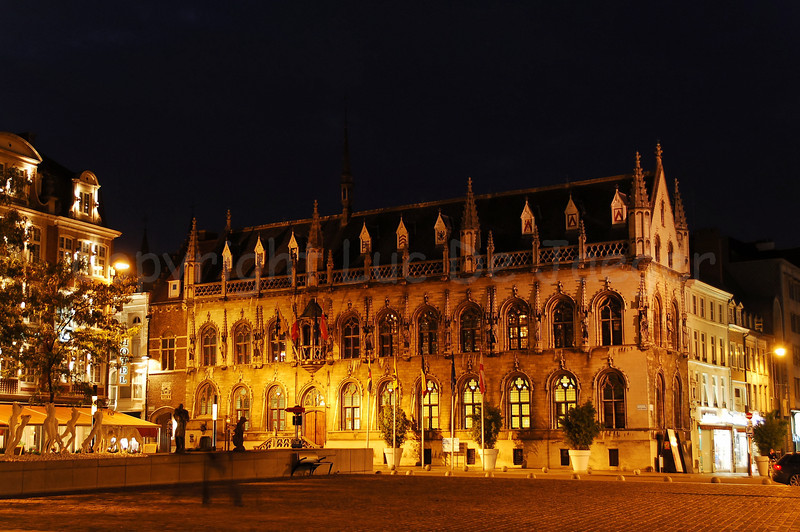 The Town Hall (stadhuis) on the main Market Square in Courtrai (Kortrijk), Belgium, captured at night.