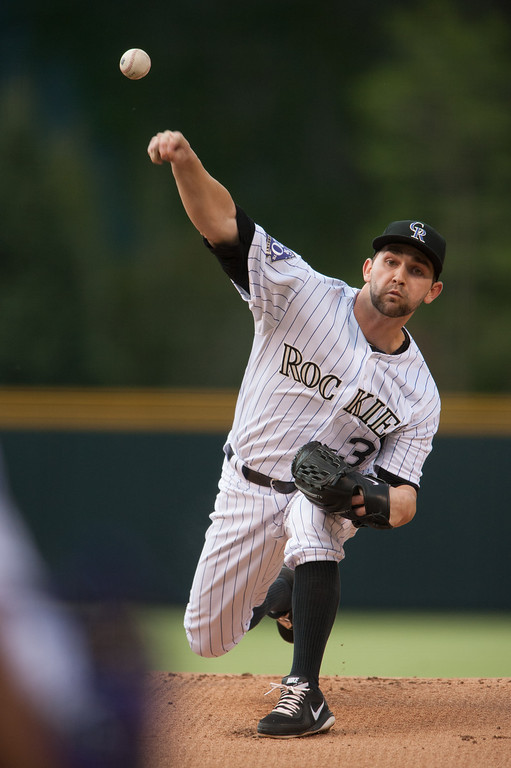 . DENVER, CO - MAY 18:  Tyler Chatwood #32 of the Colorado Rockies delivers a pitch in the first inning against the San Francisco Giants at Coors Field on May 18, 2013 in Denver, Colorado.  (Photo by Dustin Bradford/Getty Images)