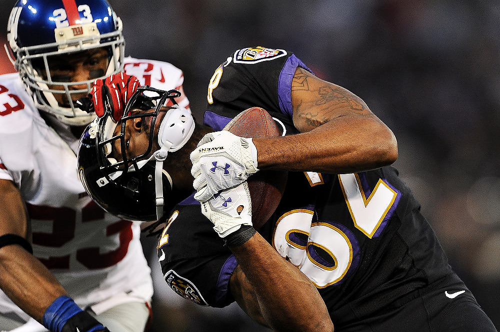 . Wide receiver Torrey Smith #82 of the Baltimore Ravens makes a catch past cornerback Corey Webster #23 of the New York Giants in the first quarter at M&T Bank Stadium on December 23, 2012 in Baltimore, Maryland. (Photo by Patrick Smith/Getty Images)