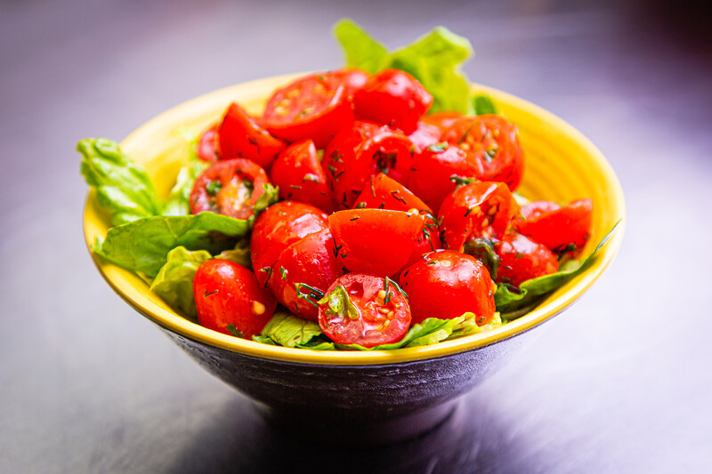 Tomato, romaine and herb salad, a side dish at Flybird Chargrill Chicken in Delray on Wednesday, October 16, 2019. [JOSEPH FORZANO/palmbeachpost.com]
