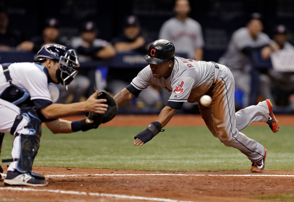 . Cleveland Indians\' Jose Ramirez, right, scores ahead of the throw to Tampa Bay Rays catcher Nicholas Ciuffo on a fielder\'s choice by Yonder Alonso during the seventh inning of a baseball game Monday, Sept. 10, 2018, in St. Petersburg, Fla. (AP Photo/Chris O\'Meara)