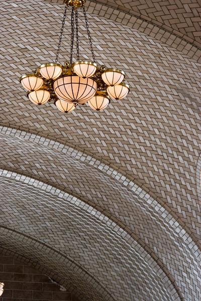 Detail of chandelier and patterned tile (Registry Room) -- Ellis Island