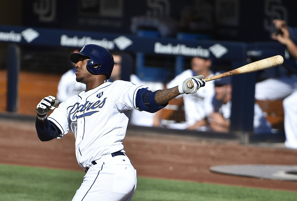 . SAN DIEGO, CA - AUGUST 13:  Rymer Liriano #7 of the San Diego Padres hits a two-run home run during the fourth inning of a baseball game against the Colorado Rockies at Petco Park on August 13, 2014 in San Diego, California.  (Photo by Denis Poroy/Getty Images)