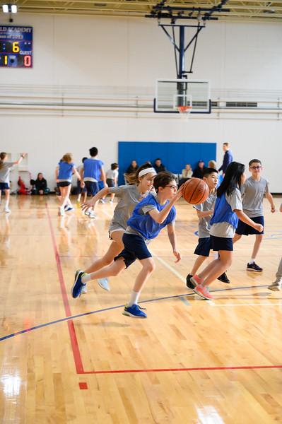Grades 4 and 5 blue vs. white basketball game
