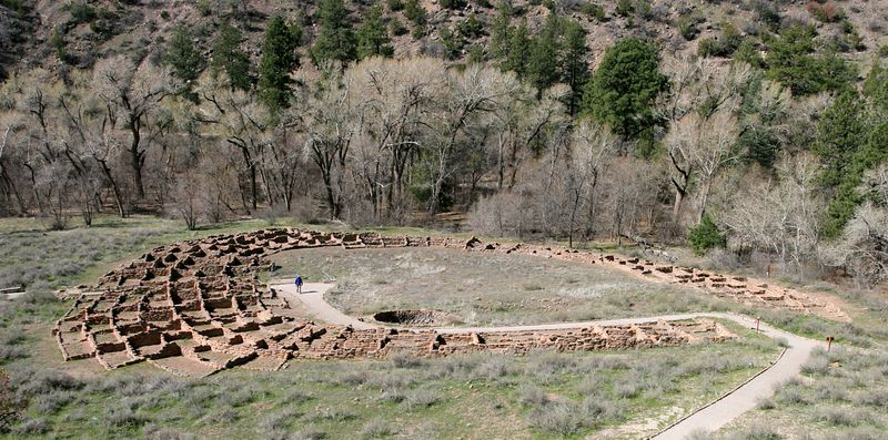 Tyuonyi Pueblo. First settled about 1100 AD. It is estimated 400-500 persons lived in this pueblo and the cliff dwellings above it for 400-500 years.