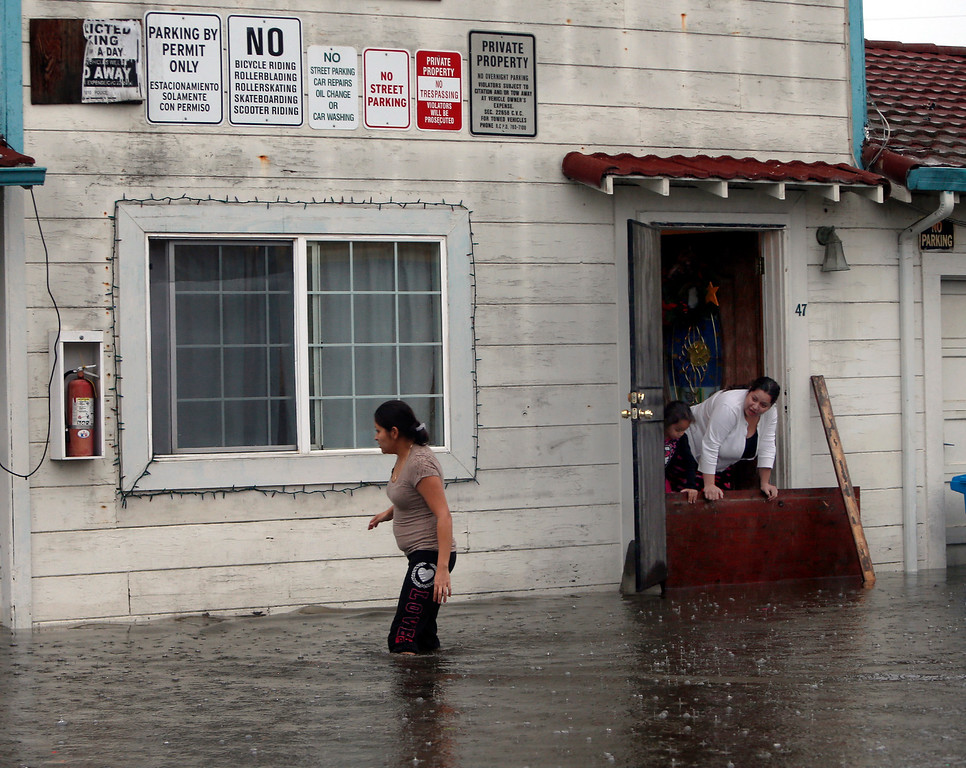 . Residents of the Le Mar Trailer Park in Redwood City, Calif., face rising waters late Thursday afternoon, Dec. 11, 2014, as a huge winter rainstorm continues to pelt Northern California. (Karl Mondon/Bay Area News Group)