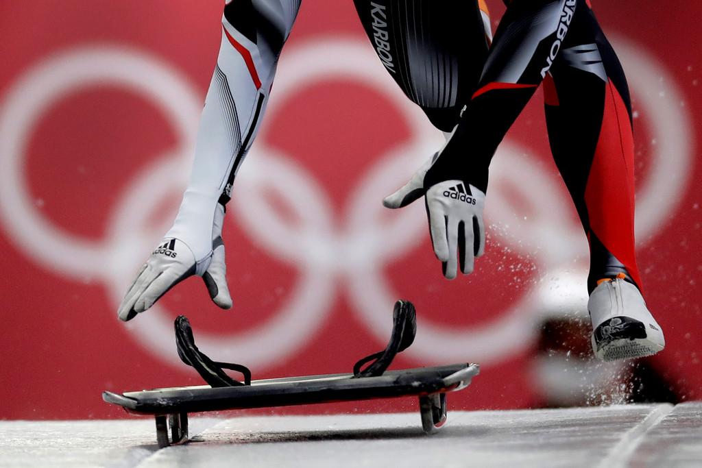 . Barrett Martineau of Canada starts his practice run for the men\'s skeleton training run at the 2018 Winter Olympics in Pyeongchang, South Korea, Wednesday, Feb. 14, 2018. (AP Photo/Wong Maye-E)