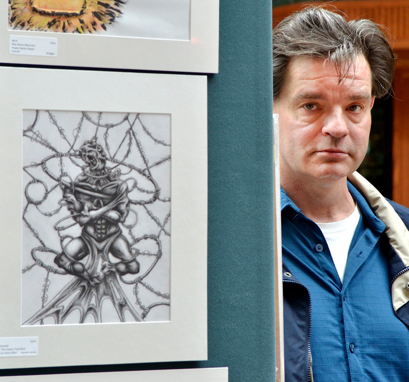 """. Jeff Forman/JForman@News-Herald.com Ed Wesolowski poses for a photo beside \""""The Art of Control,\"""" one of three pieces he has in the \""""Expressions of Recovery\"""" exhibit at the Great Lakes Mall. The show is sponsored by the Lake County ADAMHS Board."""