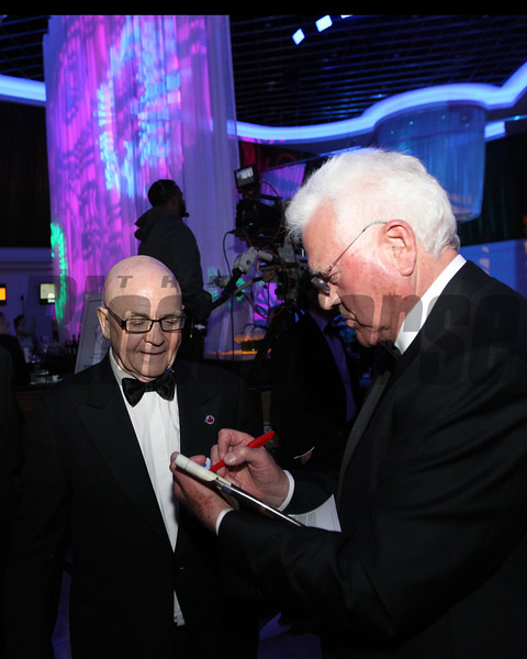 Charles Fipke receives an autograph from Frank Stronach who accepted the 2017 Eclipse Merit Award  2018 , Gulfstream Park