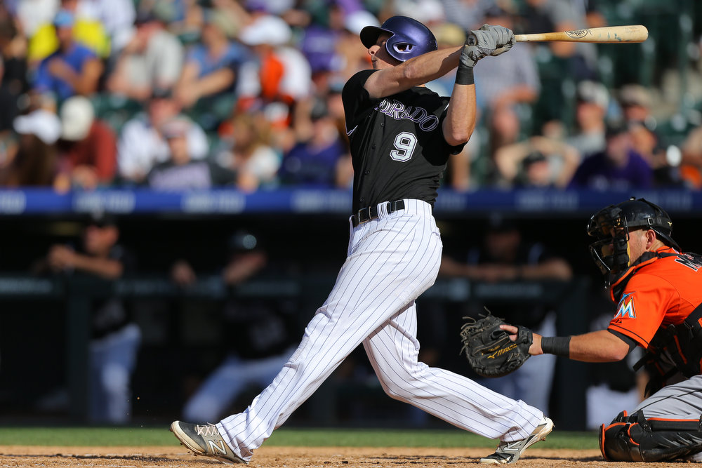 . DJ LeMahieu #9 of the Colorado Rockies hits a two-run double during the seventh inning against the Miami Marlins at Coors Field on August 24, 2014 in Denver, Colorado. The Rockies defeated the Marlins 7-4. (Photo by Justin Edmonds/Getty Images)