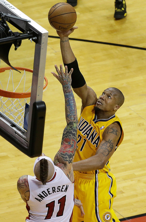 . Indiana Pacers power forward David West (21) shoots over Miami Heat power forward Chris Andersen (11) during the second half of Game 7 in their NBA basketball Eastern Conference finals playoff series, Monday, June 3, 2013 in Miami. (AP Photo/Wilfredo Lee)
