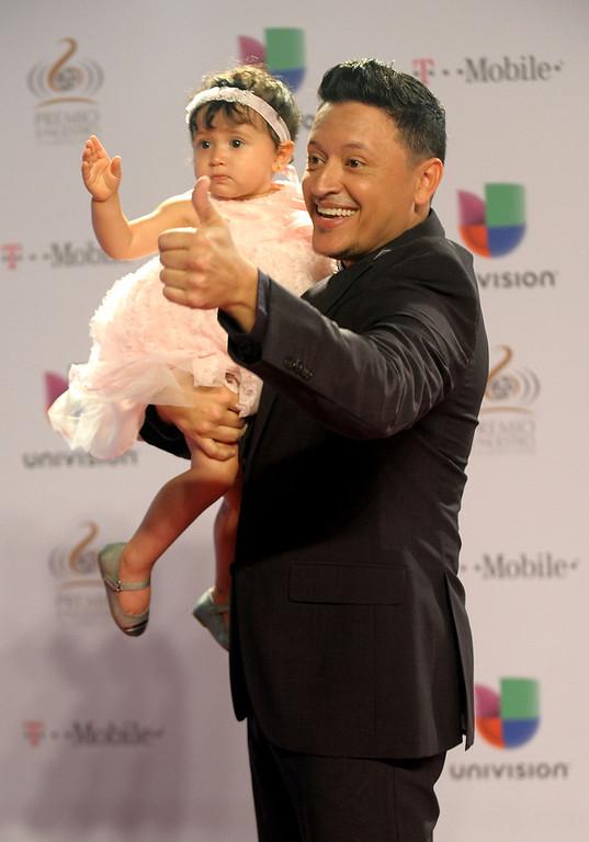 """. Elvis Crespo arrives at the 25th Anniversary Of Univision\'s \""""Premio Lo Nuestro A La Musica Latina\"""" on February 21, 2013 in Miami, Florida.  (Photo by Gustavo Caballero/Getty Images for Univision)"""