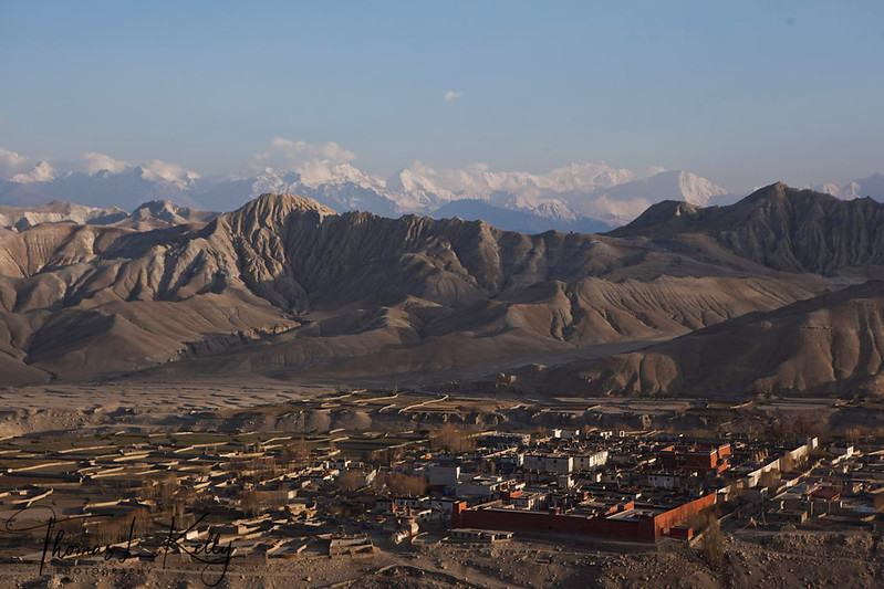 View of Lo Manthang from Kechar fort. Within the walls of the city the large white cube is the Palace and red ones are Chyodi, Champa and Tugchen temples. Mustang, Nepal.