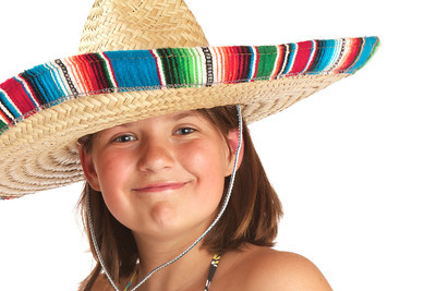 Grinning young girl in a wide brim straw hat