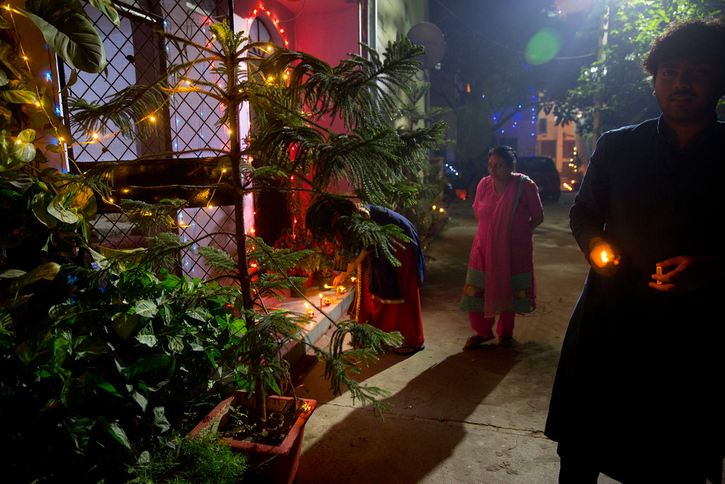 . Indians decorate their home with lamps during Diwali festival in New Delhi, India, Thursday, Oct. 19, 2017. Diwali, the Hindu festival of lights, is being celebrates across the country Thursday.  (AP Photo/Manish Swarup)