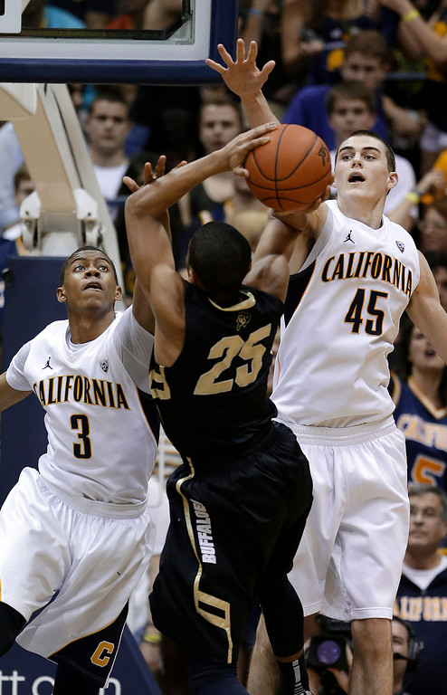 . California guard Tyrone Wallace (3) and forward David Kravish (45) defend as Colorado guard Spencer Dinwiddie (25) shoots during the second half of an NCAA college basketball game in Berkeley, Calif., Saturday, March 2, 2013. California won 62-46. (AP Photo/Jeff Chiu)