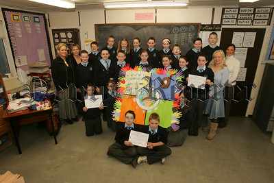 St Peter's Cloughreagh take part in the Helping Hands project in aid opf Womens aid, Pictured with the pupils are Teacher Mrs Suzanne Burns, Martina Shevlin and Ann baxter from Newry Womens Aid and Classroom Assistant Freda Mackin. 07W8N24
