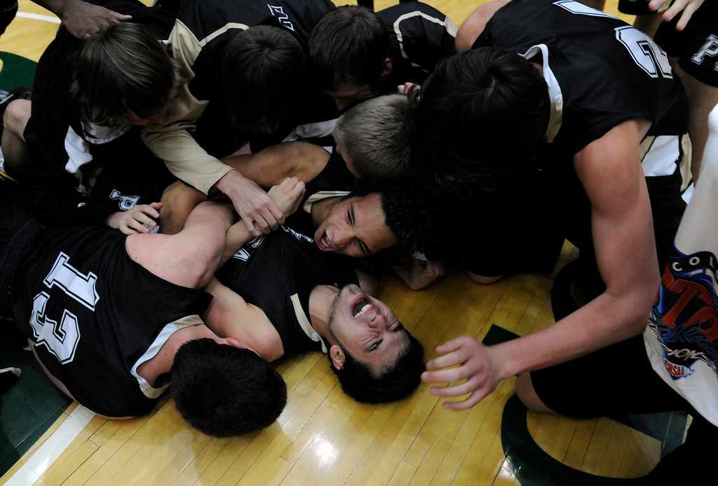 . FT. COLLINS, CO. - MARCH 16TH: Kain Lucero, Pagosa Springs, lower center, gets swarmed by his teammates as they celebrate their victory over Kent Denver 53-49 to win the 3A Boys Colorado State Championship at Moby Arena in Ft. Collins Saturday evening. (Photo By Andy Cross/The Denver Post)