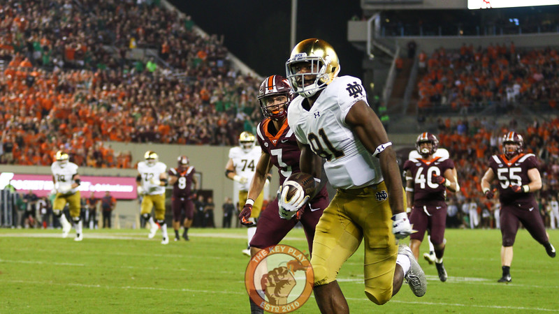 Notre Dame WR Miles Boykin runs after the catch for a touchdown as Hokies DB Caleb Farley attempts to give chase. (Mark Umansky/TheKeyPlay.com)