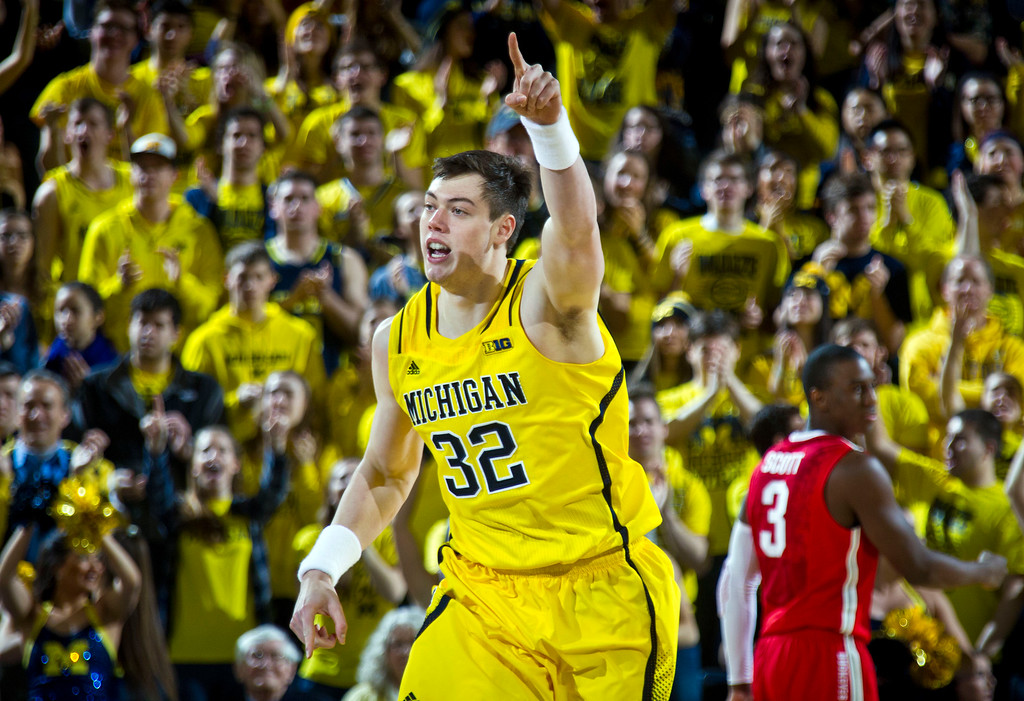 . Michigan forward Ricky Doyle (32) reacts after making a basket in the first half of an NCAA college basketball game against Ohio State at Crisler Center in Ann Arbor, Mich., Sunday, Feb. 22, 2015. (AP Photo/Tony Ding)