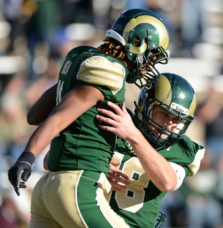 . Colorado State QB, Garrett Grayson, right, celebrates with WR, Jordon Vaden after Vaden caught a long pass for a touchdown from Grayson in the third quarter of play against Air Force Saturday afternoon, November 30, 2013. The Rams won 58-13. (Photo By Andy Cross/The Denver Post)