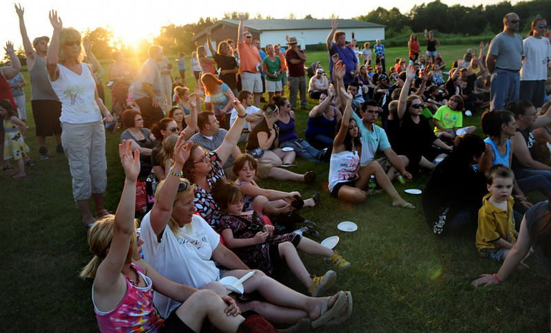 . Everybody that helped in the search was asked to raise their hands at the candlelight vigil. (Pioneer Press: Jean Pieri)