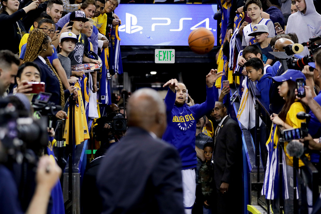 . Golden State Warriors guard Stephen Curry shoots from an aisle while warming up before Game 1 of basketball\'s NBA Finals between the Warriors and the Cleveland Cavaliers in Oakland, Calif., Thursday, May 31, 2018. (AP Photo/Marcio Jose Sanchez)