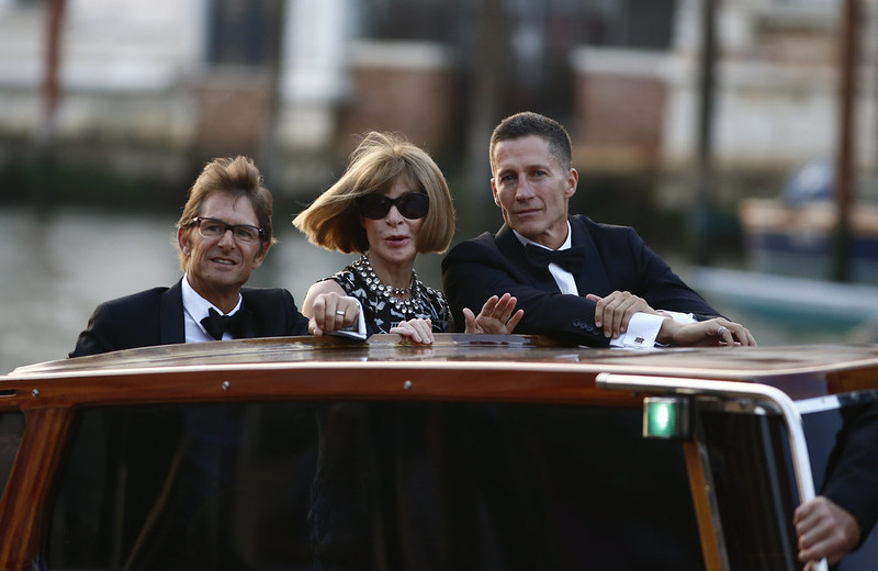""". Anna Wintour (C) and Bruce Bozzi Jr. (R) arrive at Palazzo Papadopoli, Hotel Aman, on a taxi boat on September 27, 2014 in Venice where Clooney and British fiancee, Amal Alamuddin celebrate their wedding. George Clooney has said goodbye to bachelorhood in Venice with a stag party at his favorite restaurant with Hollywood chums, and was gearing up for a day of glamorous pre-wedding celebrations. The actor had swept into the floating city yesterday with his British fiancee Amal Alamuddin on a watertaxi dubbed \""""Amore\"""", zipping up the Grand Canal to cheers from fans at the start of nuptials set to draw out over the weekend.    PIERRE TEYSSOT/AFP/Getty Images"""