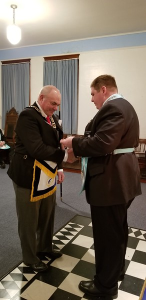 WBro. Stan Weidner receives the Jewel of Masonic Relief as a gift from the Lodge