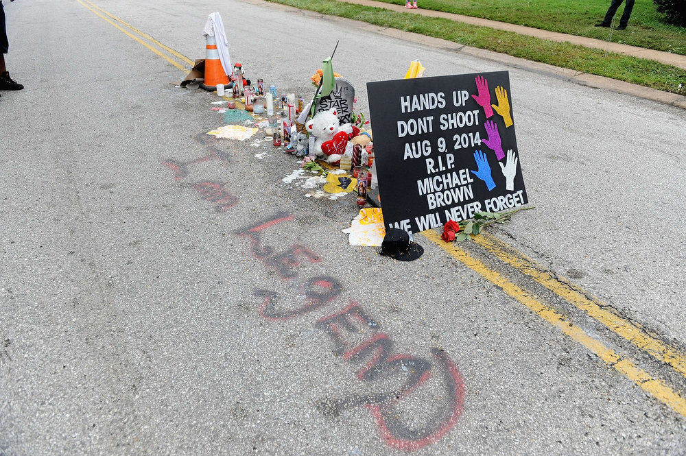 . A memorial setup in the place where Michael Brown Jr. was killed in Canfield Apartments in Ferguson, MO. Violent protests have erupted nearly every night along the street since the shooting death of teenager Michael Brown by a Ferguson police officer on August 9.   Michael B. Thomas/AFP/Getty Images