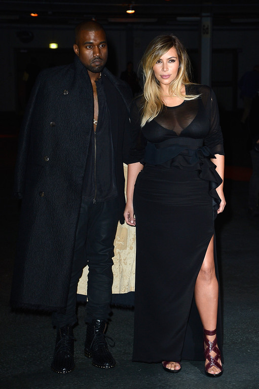 . PARIS, FRANCE - SEPTEMBER 29:  Kim Kardashian and Kanye West attend the Givenchy show as part of the Paris Fashion Week Womenswear  Spring/Summer 2014 on September 29, 2013 in Paris, France.  (Photo by Pascal Le Segretain/Getty Images)