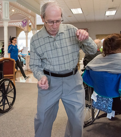 05/15/18 Wesley Bunnell | Staff Singer Kate Stone entertained the residents of Autumn Lake Healthcare in New Britain during Happy Hour on Wednesday May 15th. Sebby Lanza, L, whose wife is a resident of the facility dances as Stone performs.