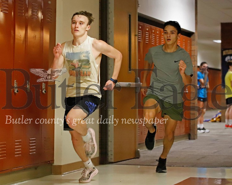 Butler indoor track team runners Alex Karenbauer (left) and Guinness Brown practice sprints during practice at the intermediate high school. Seb Foltz/Butler Eagle 02/11/20