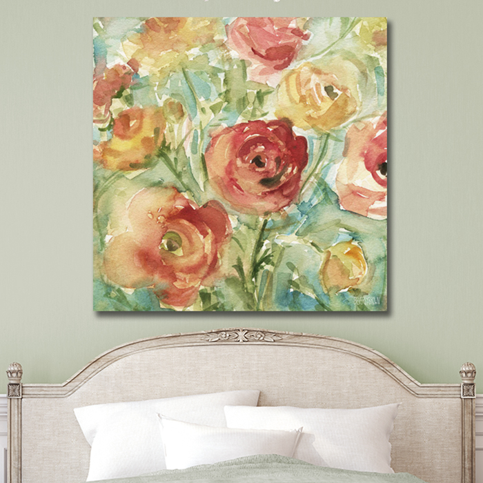 Red Orange and Yellow Ranunculus floral large canvas wall art in a shabby chic farmhouse bedroom over the headboard. Watercolor painting print by Beverly Brown. This beautiful floral print is painted in shades of light orange, golden yellow, light red and spring green with a touch of teal green. Perfect for shabby chic, farmhouse, modern rustic, traditional or transitional decor. Available on canvas, metal, acrylic or fine paper in multiple sizes with custom framing - beverlybrown.com