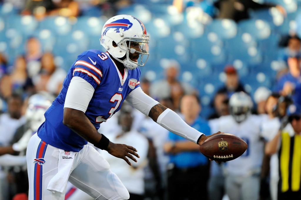 . Buffalo Bills quarterback EJ Manuel looks to hand off during the first half of a preseason NFL football game against the Detroit Lions, Thursday, Aug. 28, 2014, in Orchard Park, N.Y. (AP Photo/Gary Wiepert)