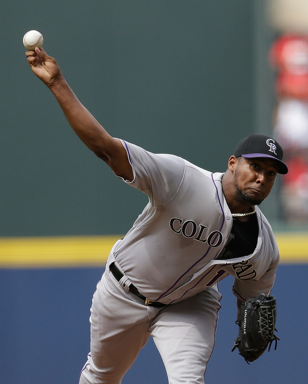 . Pitcher Juan Nicasio #12 of the Colorado Rockies throws a pitch in the first inning of the game against the Atlanta Braves  at Turner Field on May 24, 2014 in Atlanta, Georgia.  (Photo by Mike Zarrilli/Getty Images)