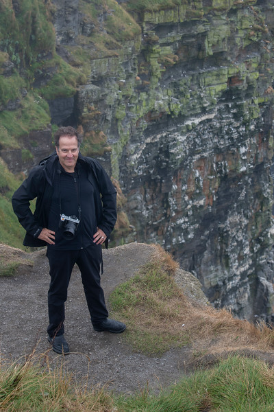 Man standing on cliff, Cliffs of Moher, Lahinch, County Clare, Ireland