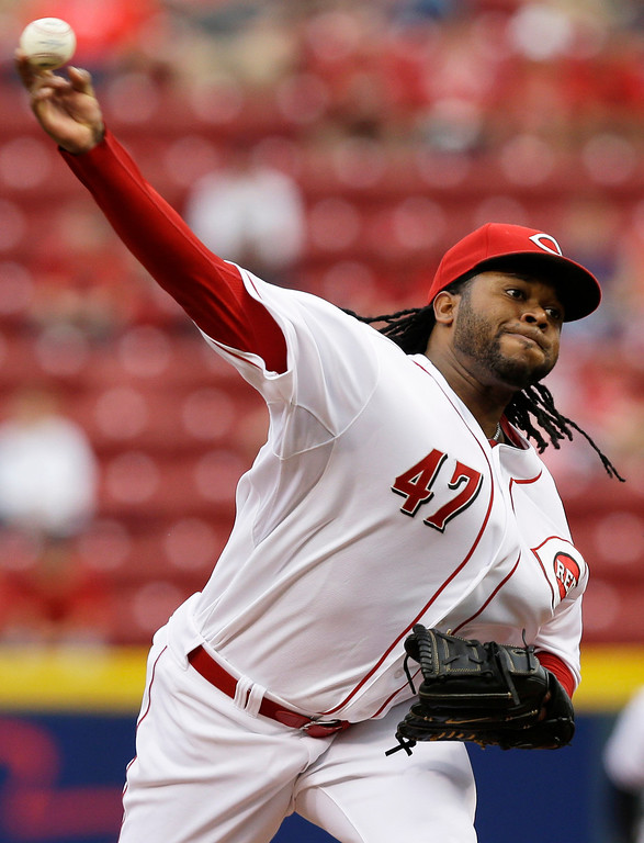 . Cincinnati Reds starting pitcher Johnny Cueto throws against the Colorado Rockies in the first inning of a baseball game on Friday, May 9, 2014, in Cincinnati. (AP Photo/Al Behrman)