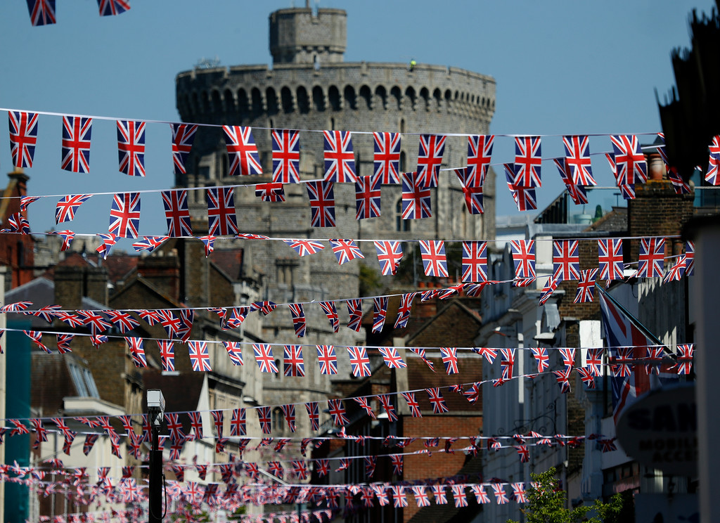 . Union Jack flags fly across the main shopping street in Windsor, Tuesday, May 15, 2018. Preparations are being made in the town ahead of the wedding of Britain\'s Prince Harry and Meghan Markle that will take place in Windsor on Saturday May 19. (AP Photo/Frank Augstein)