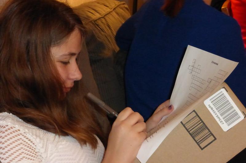 Lauren working on her crossword puzzle.