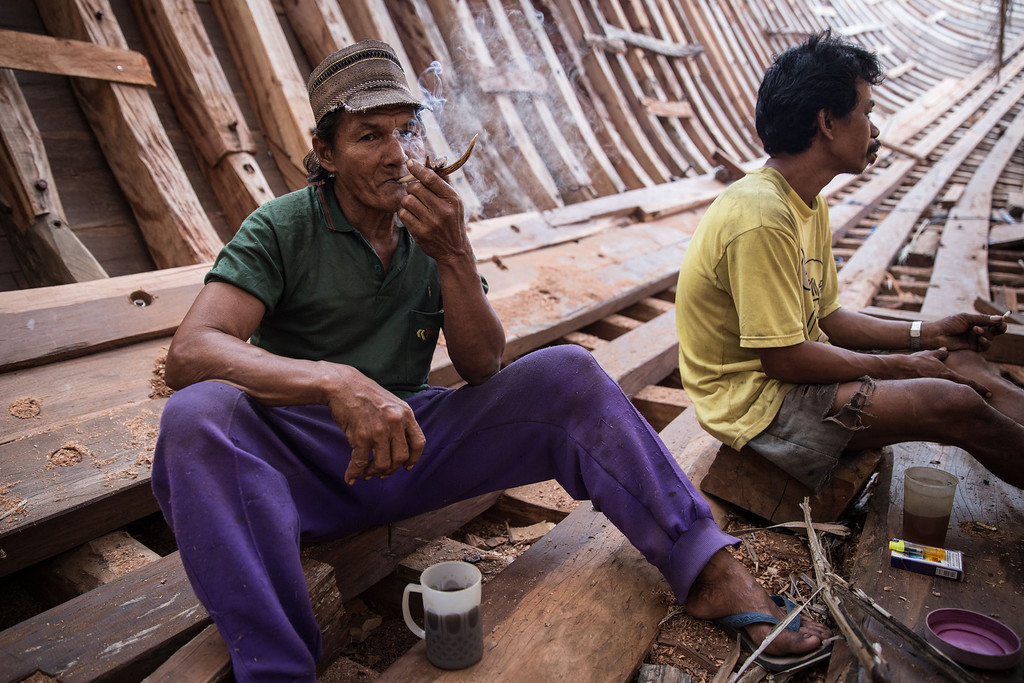 . Buginese men take a rest in the hull of phinisi at Tanjung Bira Beach on May 2, 2014 in Bulukumba, South Sulawesi, Indonesia.   (Photo by Agung Parameswara/Getty Images)