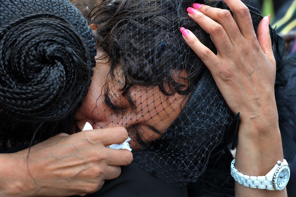 . Lindiwe Sisulu, a South African politician, reacts after the funeral service of  former South African President Nelson Mandela in Qunu, South Africa, Sunday, Dec. 15, 2013.  (AP Photo/Elmond Jiyane, GCIS)