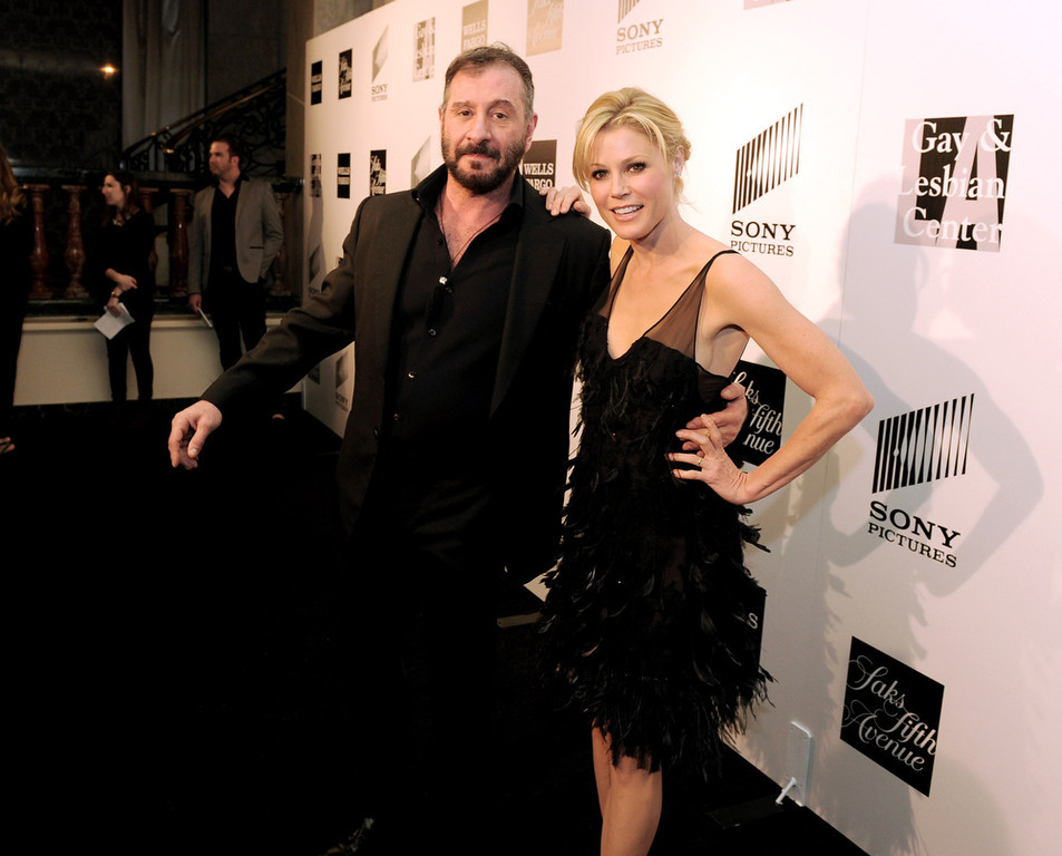 ". Honoree fashion designer Ralph Rucci (L) and actress Julie Bowen arrive at ""An Evening\"" benifiting The L.A. Gay & Lesbian Center at the Beverly Wilshire Hotel on March 21, 2013 in Beverly Hills, California.  (Photo by Kevin Winter/Getty Images)"