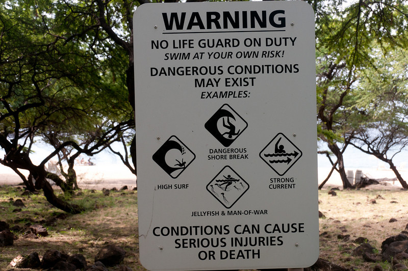 Warning signs near the beach in Lanai, Hawaii