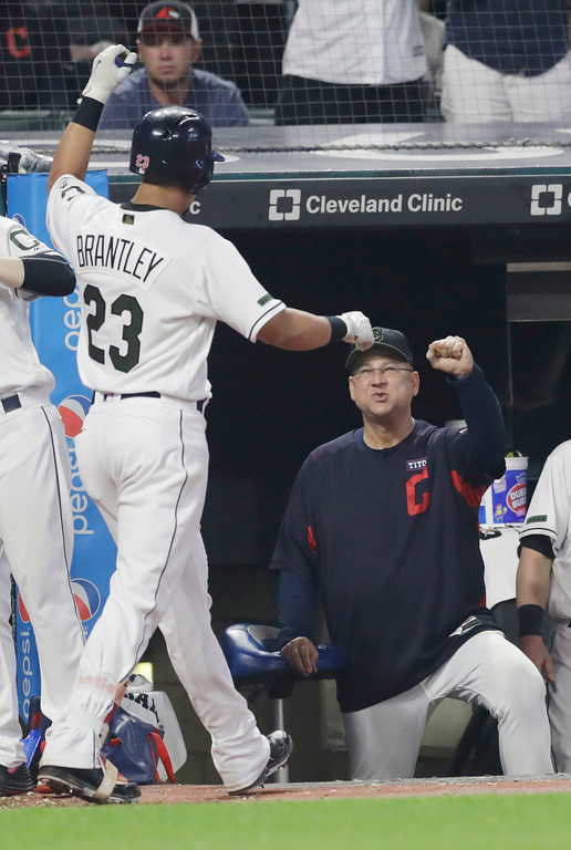 . Cleveland Indians manager Terry Francona, right, congratulates Michael Brantley after Brantley hit a solo home run during the seventh inning of a baseball game against the Houston Astros, Saturday, May 26, 2018, in Cleveland. (AP Photo/Tony Dejak)