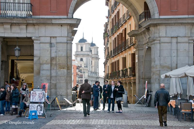 Mon 3/07 in Madrid: Plaza Mayor looking out to Calle de los Cuchilleros