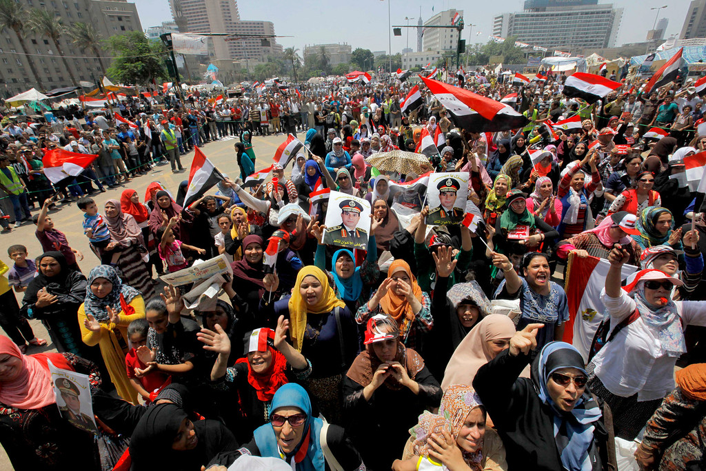 . Opponents of Egypt\'s ousted president Mohammed Morsi wave national flags and posters of Lt. Gen. Abdel-Fattah el-Sissi during a rally in Tahrir Square, in Cairo, Egypt, Friday, July 5, 2013. Egypt\'s Muslim Brotherhood called for a wave of protests Friday, furious over the military\'s ouster of its president and arrest of its revered leader and other top figures, raising fears of violence and retaliation from Islamic militants. (AP Photo/Amr Nabil)